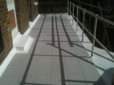 Expert Flat Roofing - GRC Tiles on Asphalt Walkway