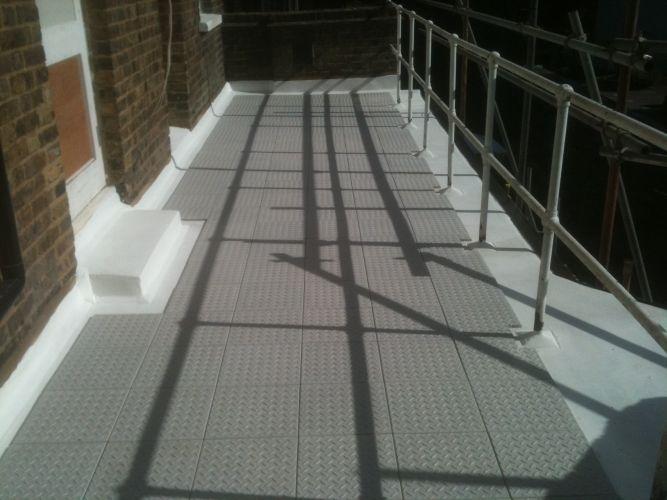 Expert Flat Roofing - GRC Tiles on Asphalt Walkway